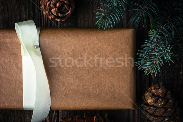 Homemade present with fir tree and  cone. Christmas theme Stock photo © Karpenkovdenis