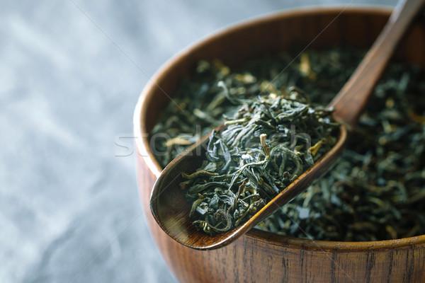 Tea leaves on the wooden bowl on the  dark stone background horizontal Stock photo © Karpenkovdenis