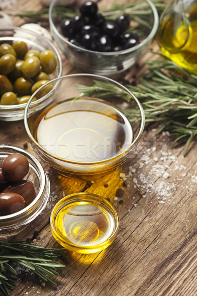 Olive oil  with olives mix  on the wooden table  vertical Stock photo © Karpenkovdenis