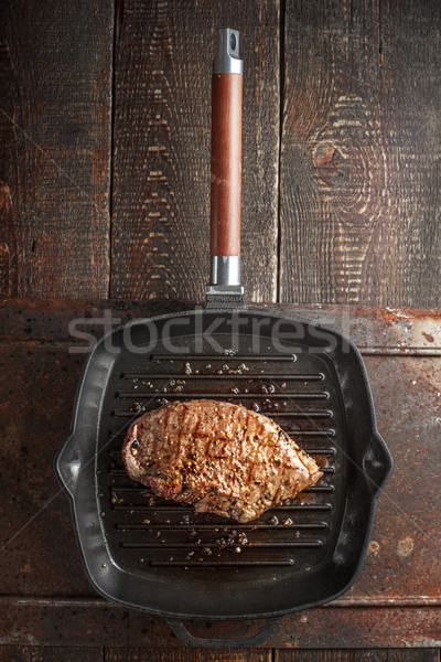 Roast beef steak in spices on pan grill on the table Stock photo © Karpenkovdenis