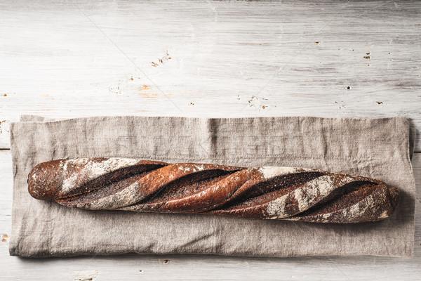 багет салфетку белый деревянный стол горизонтальный продовольствие Сток-фото © Karpenkovdenis