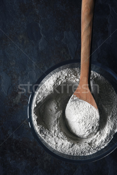 Flour in the glass bowl on the stone table vertical Stock photo © Karpenkovdenis