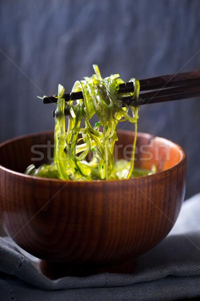 китайский палочки для еды Салат вертикальный фон таблице Сток-фото © Karpenkovdenis