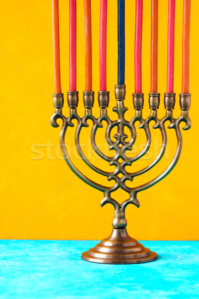 Hanukkah menorah with candles on the yellow background vertical Stock photo © Karpenkovdenis