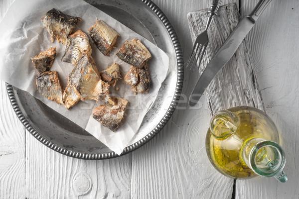 Piatto pesce olio d'oliva tavolo in legno orizzontale casa Foto d'archivio © Karpenkovdenis