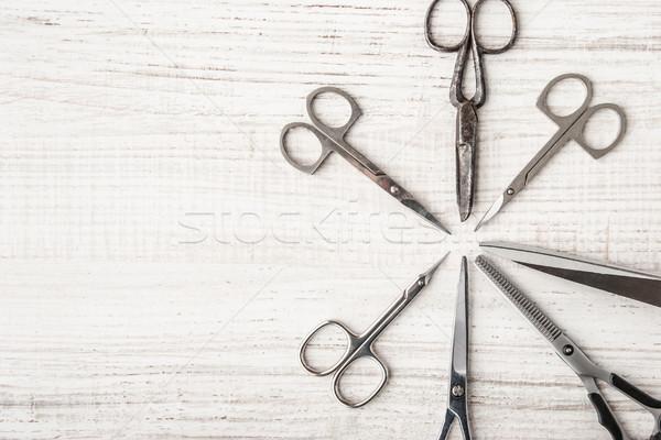 Set of scissors on a wooden table  Stock photo © Karpenkovdenis