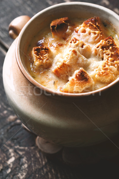Onion soup in the ceramic pot on the  wooden table Stock photo © Karpenkovdenis