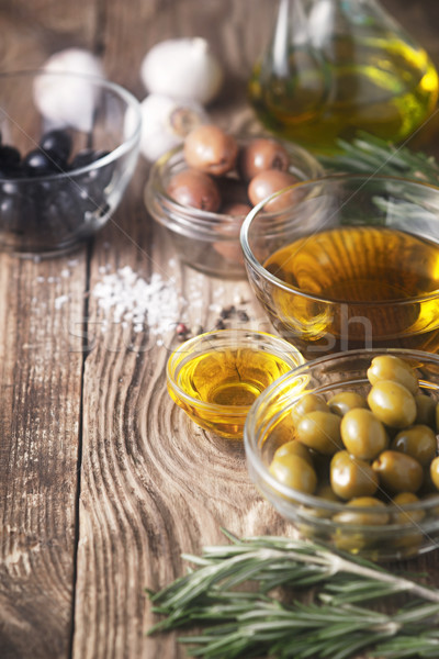 Olive oil  and olives on the wooden table Stock photo © Karpenkovdenis