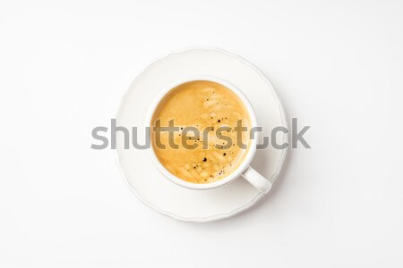 Coffee in ceramic cup on a white table Stock photo © Karpenkovdenis