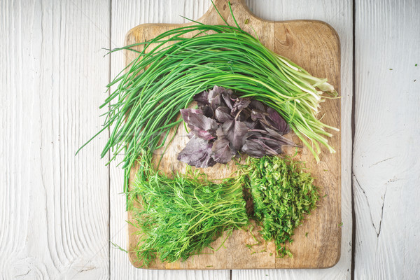 Basil, onion, dill on cutting board Stock photo © Karpenkovdenis