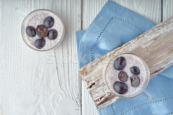Chia pudding with grapes on the white wooden table top view Stock photo © Karpenkovdenis