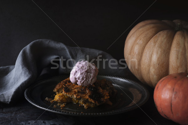 Pumpkin dump cake with ice cream on the metal plate on the stone table Stock photo © Karpenkovdenis