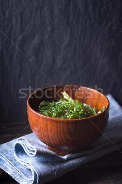 Chuka salad  in the wooden bowl  on the dark background vertical Stock photo © Karpenkovdenis