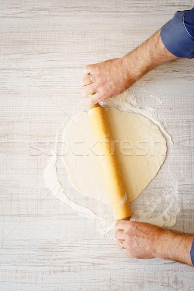 Rolling dough on the white table Stock photo © Karpenkovdenis