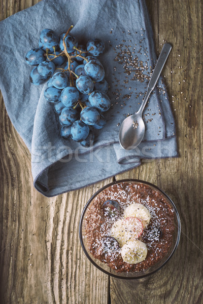 Chocolate chia pudding with fruit in the glass bowl top view Stock photo © Karpenkovdenis