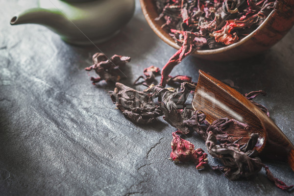 Set for hibiscus tea  preparation on the dark stone table Stock photo © Karpenkovdenis