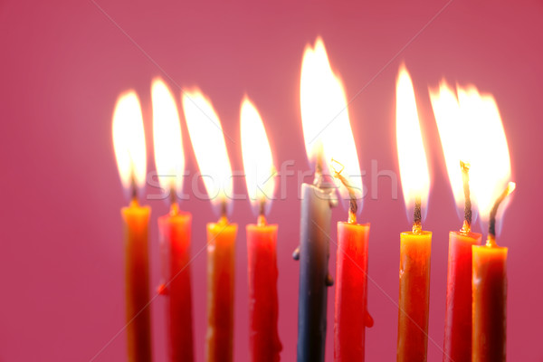 Hanukkah  burning candles on the pink background Stock photo © Karpenkovdenis