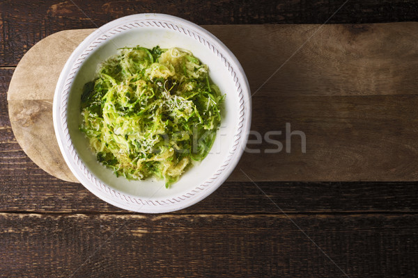Zucchini noodles with cheese on the wooden table top view Stock photo © Karpenkovdenis