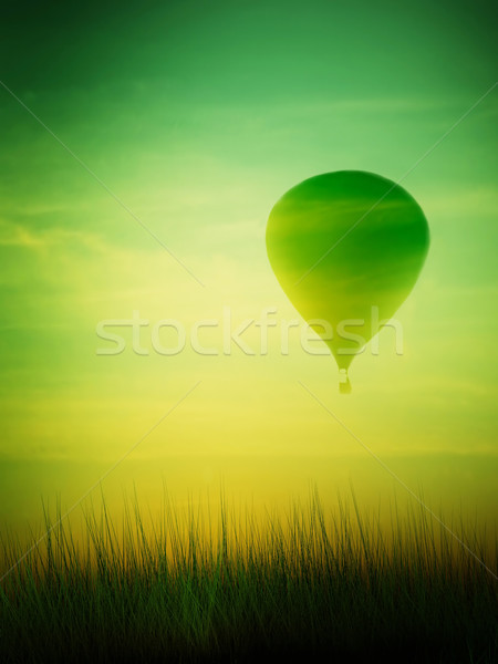 Stock photo: Hot air balloon flying at sunrise