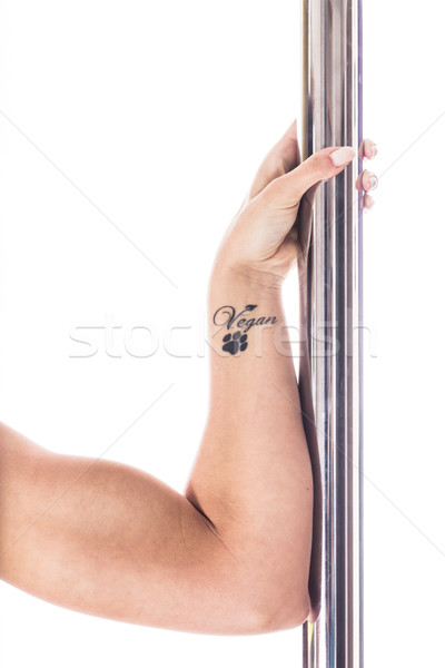 Hand of young vegan pole dancer Stock photo © kasjato