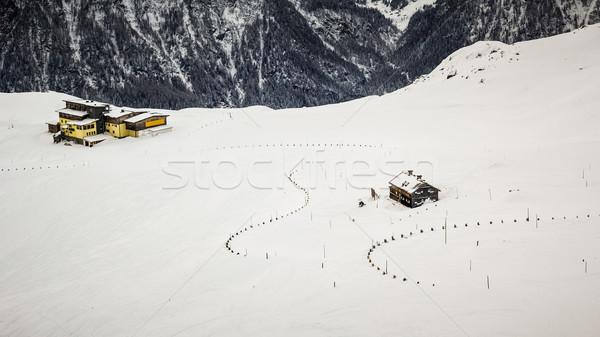 Montanha abrigo alpes inverno céu sol Foto stock © kasjato