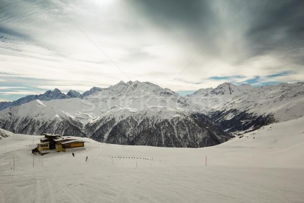 Berg onderdak alpen winter hemel zon Stockfoto © kasjato