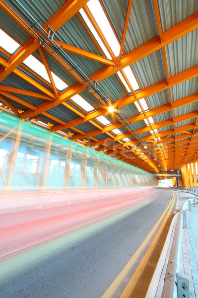 Orange tunnel at daytime with moving bus Stock photo © kawing921