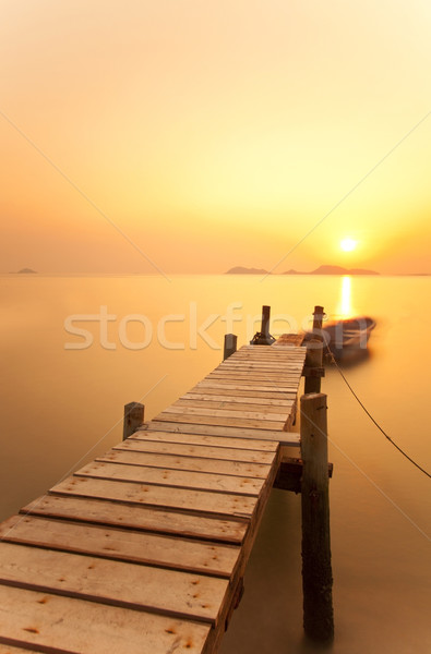 Jetty sunset over the ocean  Stock photo © kawing921