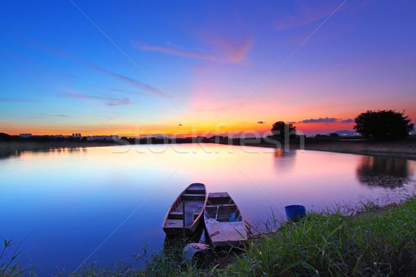 Naplemente tavacska kettő hajók varázslatos szín Stock fotó © kawing921