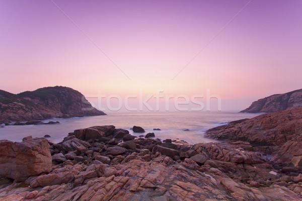 Tenger kövek part napfelkelte égbolt víz Stock fotó © kawing921