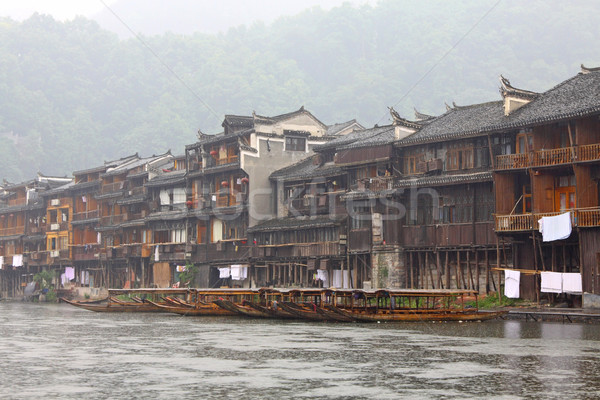 Boats and wooden houses at Phoenix Town - Fenghuang ancient town Stock photo © kawing921