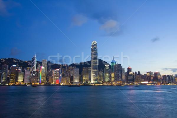 Hongkong kikötő éjszaka üzlet iroda épület Stock fotó © kawing921