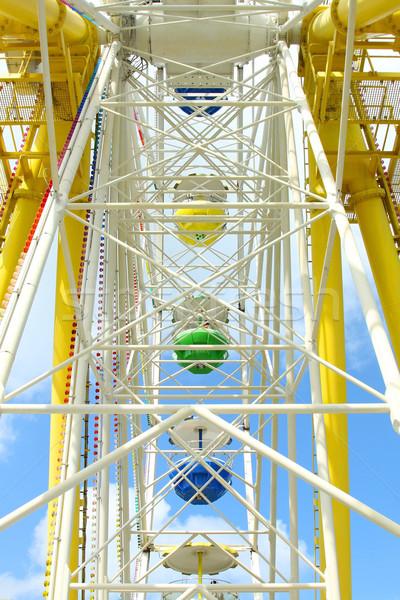Ferris wheel against a blue sky  Stock photo © kawing921