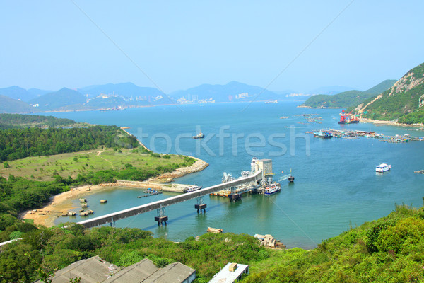 Coastline with mountain ridges in Hong Kong at day time Stock photo © kawing921