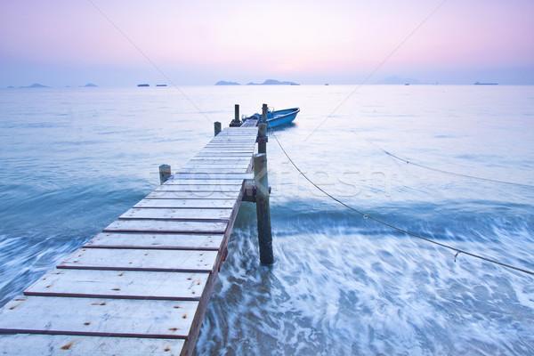 Jetty sunset along coast with waves movement Stock photo © kawing921