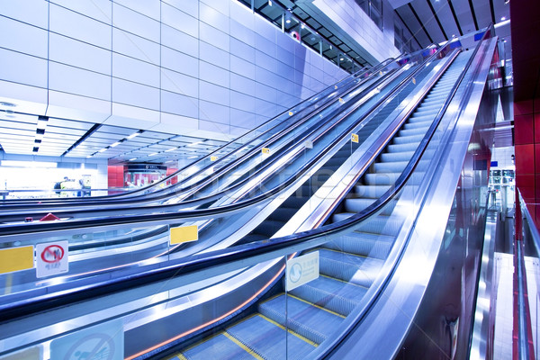 Stock photo: Moving escalator in blurred motion