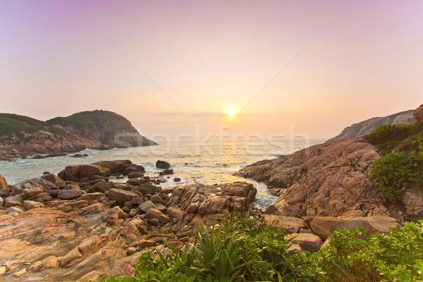 Mar rochas costa nascer do sol praia céu Foto stock © kawing921