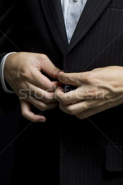 Iş adamı düzenli yukarı suit düğme Stok fotoğraf © kawing921