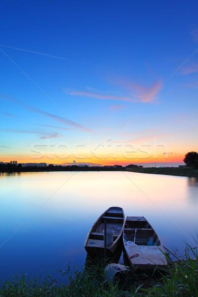 Pôr do sol lagoa dois barcos céu floresta Foto stock © kawing921