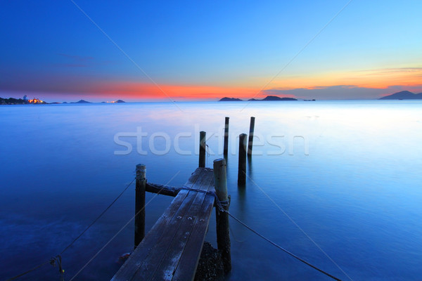 Sunset at dusk along a wooden pier, high saturation image. Stock photo © kawing921