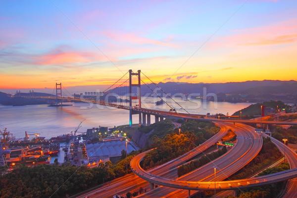Ponte Hong Kong pôr do sol tempo céu água Foto stock © kawing921