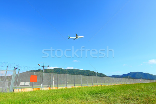 Airplane fly over grasses at day time Stock photo © kawing921