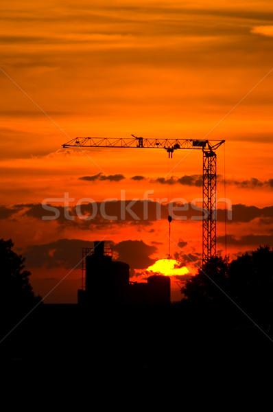 Сток-фото: крана · закат · силуэта · завода · назад · небе