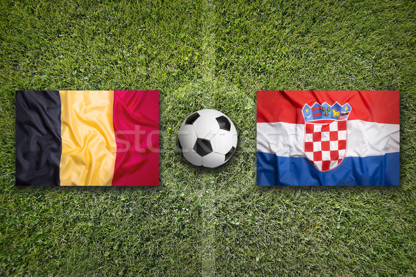 Belgique vs Croatie drapeaux terrain de football vert Photo stock © kb-photodesign