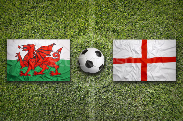Wales vs. England flags on soccer field Stock photo © kb-photodesign