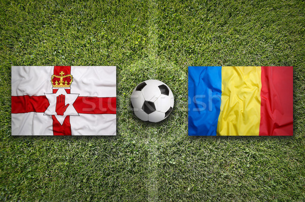 Northern Ireland vs. Romania flags on soccer field Stock photo © kb-photodesign