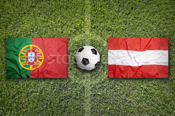 Portugal vs. Austria flags on soccer field Stock photo © kb-photodesign