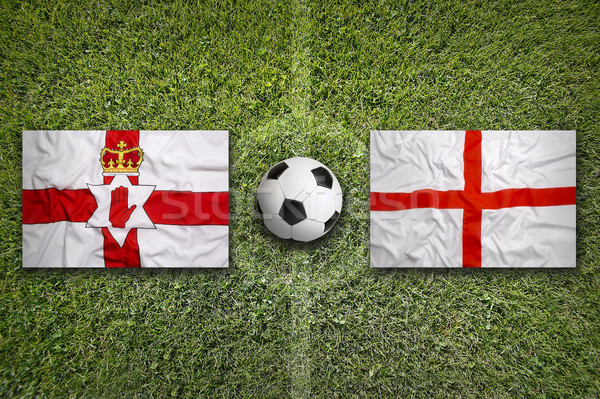 Northern Ireland vs. England flags on soccer field Stock photo © kb-photodesign