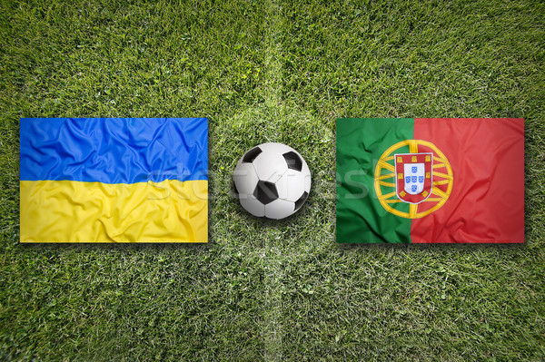 Ukrajna vs Portugália zászlók futballpálya zöld Stock fotó © kb-photodesign