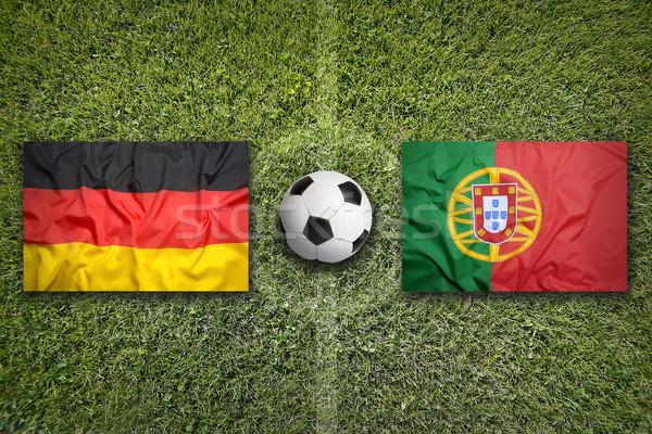 Германия против Португалия флагами футбольное поле зеленый Сток-фото © kb-photodesign